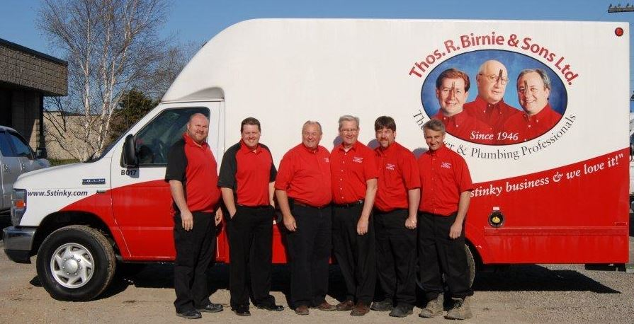 The 5Stinky team in front of the van with corporate vinyl graphics with the Thos R Birnie branding