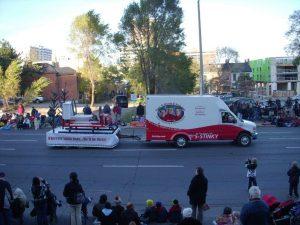 Thos R Birnie van at the Christmas parade in Hamilton