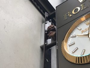 Sign professional reinstalling the Rolex Clock after it has been serviced