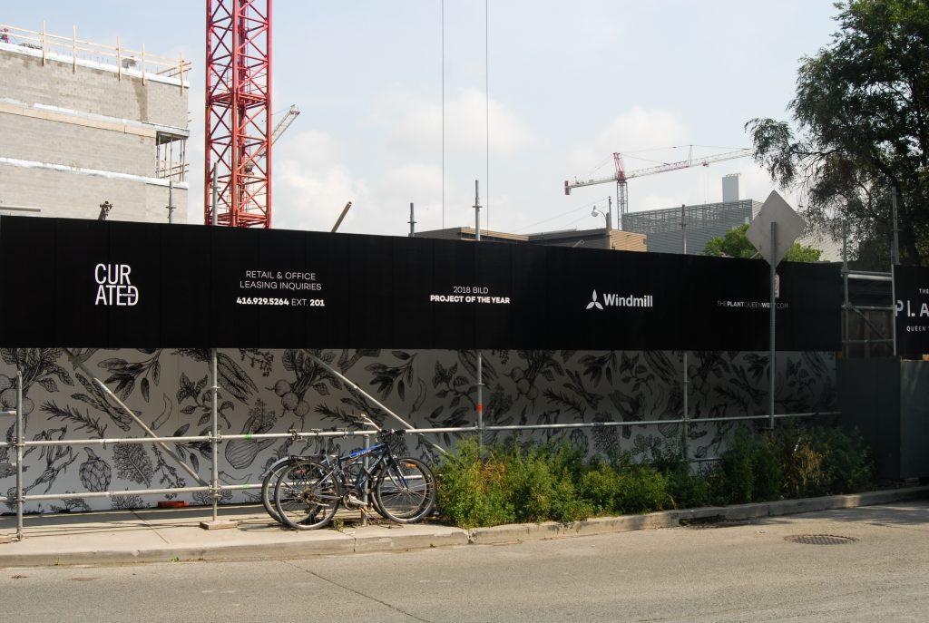 Greenloc Environmental Hoarding creates a pedestrian walkway at Windmill Development's The Plant project in Toronto.
