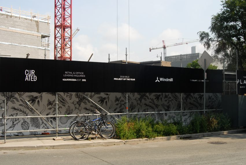 Greenloc Environmental Hoarding creates a pedestrian walkway at Windmill Development's The Plant project in Toronto.